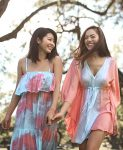 two girls wearing flowy blue and pink clothes from Angels by the Sea Hawaii