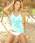 "young woman wearing a light blue ""aloha"" tank top on the beach"