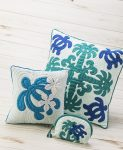 two blue, green, and white quilted Hawaiian pillows and a small pouch, all with turtle motifs by Moana Quilts